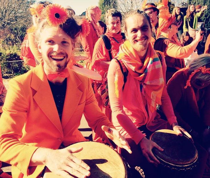 smiling orange boy drummers